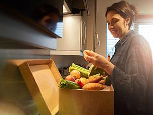 Woman unpacking meal kit box