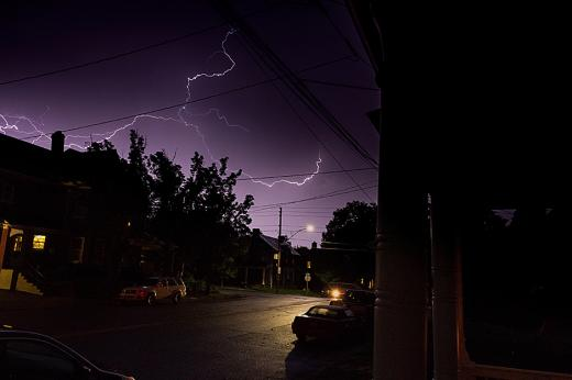 A photo looking out at a lightning storm.